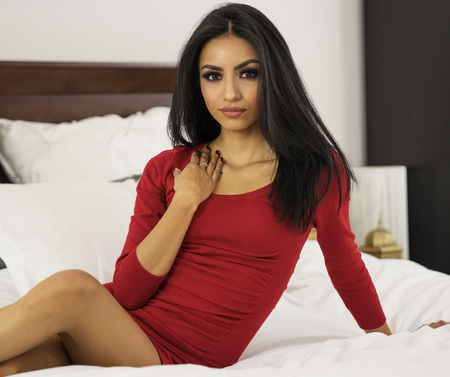 Beautiful elegant woman in red dress