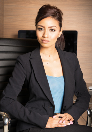 woman business suit: Attractive business woman sitting on office chair