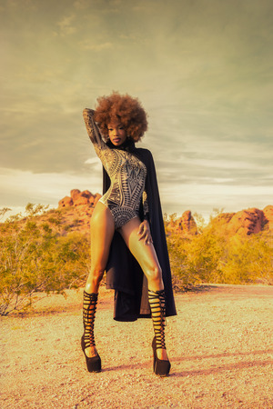 Beautiful woman standing proudly in wild desert location photo