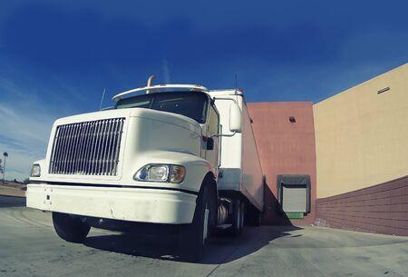 Heavy goods truck at warehouse loading doc