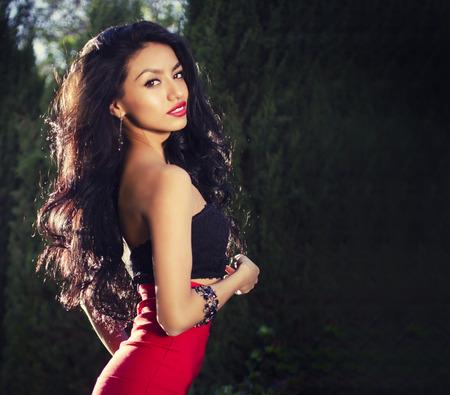 Beautiful exotic young woman long hair Banco de Imagens
