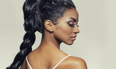 Profile womans face braided hair