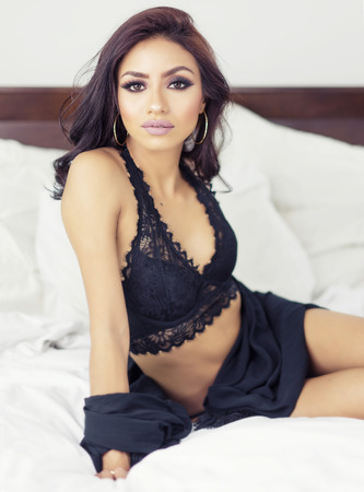 Beautiful woman in black lace lingerie