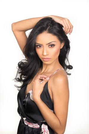 Beautiful exotic woman with long hair wearing dress