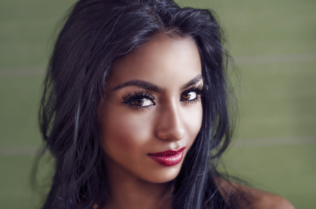 Beautiful young woman with dark exotic looks