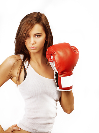 Strong healthy fit young woman wearing boxing glove