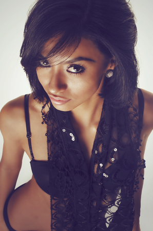 Beautiful young woman with dark exotic looks.
