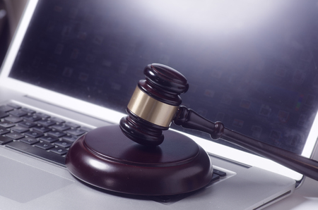 Gavel on laptop computer