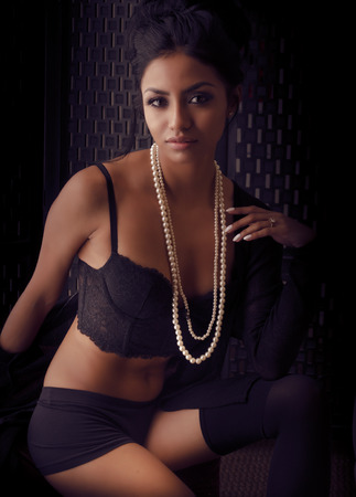 Beautiful exotic woman wearing lingerie and beads
