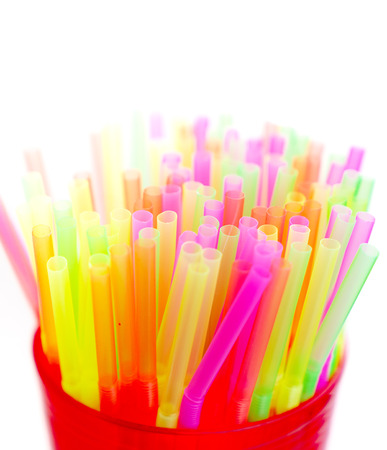 Colorful plastic straws close up photo