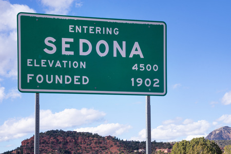 Sedona road sign with red rock mountain background