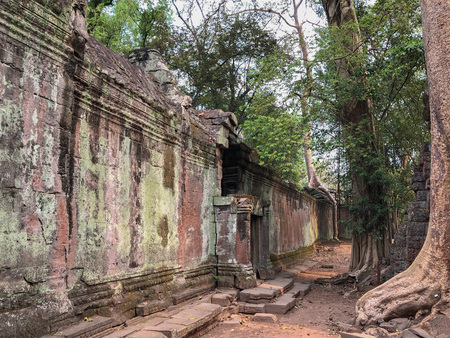 Angkor Cambodia Ancient wall Temples background and exotic travel imagery Imagens - 121101278
