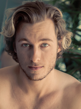Handsome young man blonde hair, stubble no shirt Imagens - 121649816