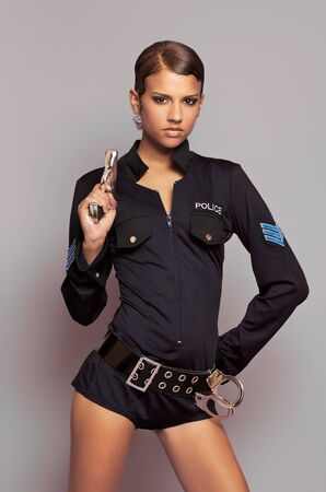 Beautiful woman dressed in cosplay police officer uniform 版權商用圖片