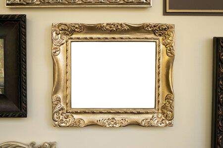 Gold frame on wall, blank picture for your content. Stock Photo