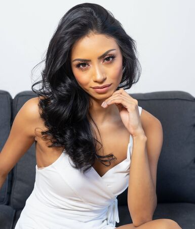Beautiful young woman's face with gorgeous curly black hai