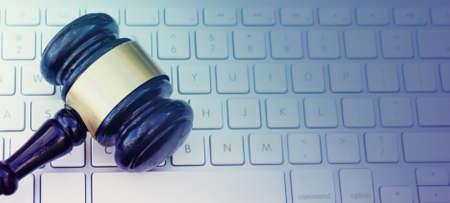 Gavel on computer laptop keyboard 免版税图像