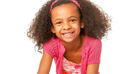 Smiling happy little girl with beautiful curly frizzy hair