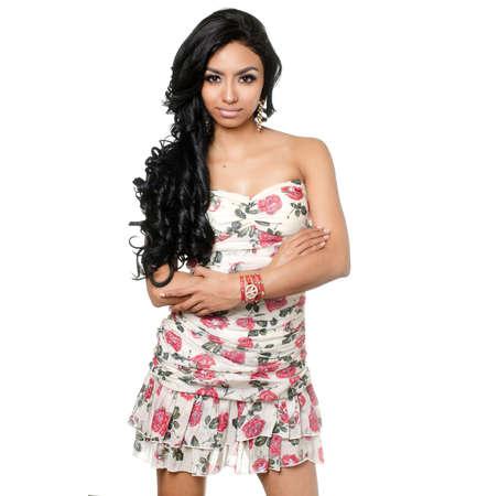 Beautiful woman with long dark hair wearing floral dress