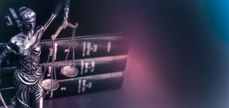 Legal law concept image Scales of Justice and case books on desk.
