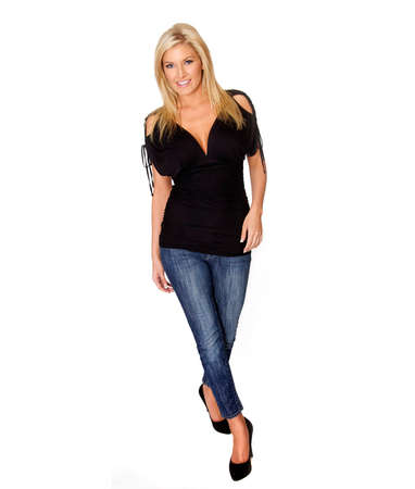 Attractive blonde woman smiling in casual work clothing. Full body image isolated against white. 免版税图像