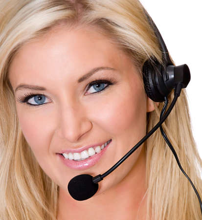 Attractive woman working from home using phone headset
