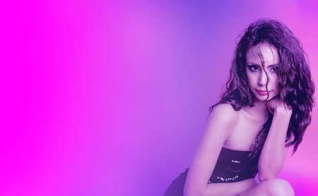 Beautiful exotic young woman wearing black dress 免版税图像