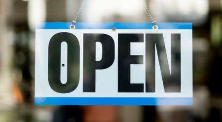 Open Business sign hanging inside store 免版税图像