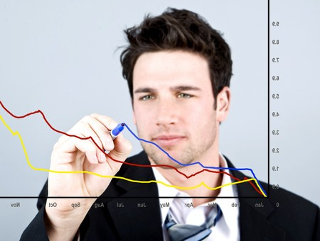 Attractive business man drawing on a graph Stock Photo - 4408779