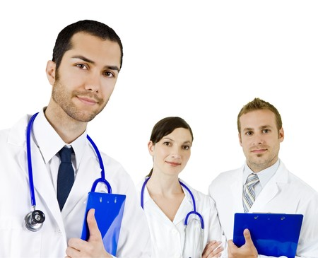 Attractive diverse doctors isolated on white