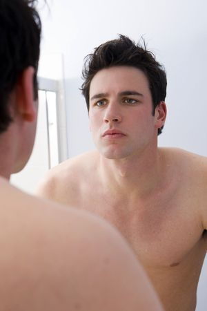 Man looking at his reflection Stock Photo