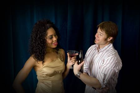 Attractive friends at a club drinking Stock Photo - 4874370