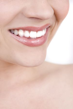 dentition: Clean, beautiful womans smile isolated on white Stock Photo