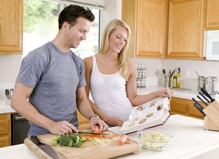 Attractive young couple in the kitchen Stock Photo - 4874378