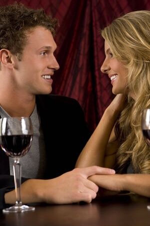 Attractive couple drinking wine together Stock Photo - 4874376