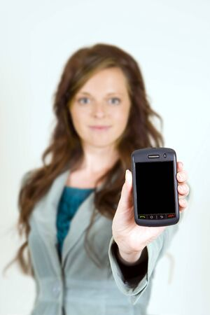 Woman holding out her phone - focus on phone with blank space for copy Stock Photo - 4874410
