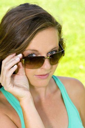 Young girl peeking over her sunglasses Stock Photo - 4874364