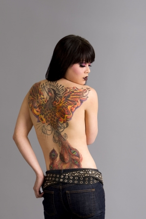 back belt: Beautiful exotic woman with colorful tattoo
