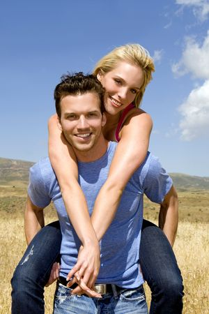 Attractive young couple playing outside Stock Photo