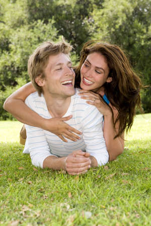 Loving young couple playing outside photo
