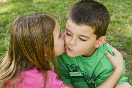 Sister giving her brother a kiss on the cheek Stock Photo - 4925725