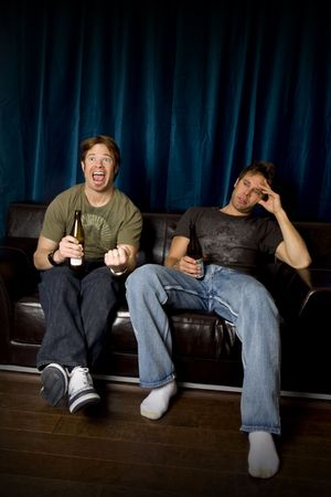 Friends watching the game on tv Stock Photo - 4949909