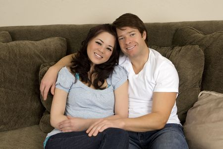 Young couple realxing on a couch Stock Photo - 4949985