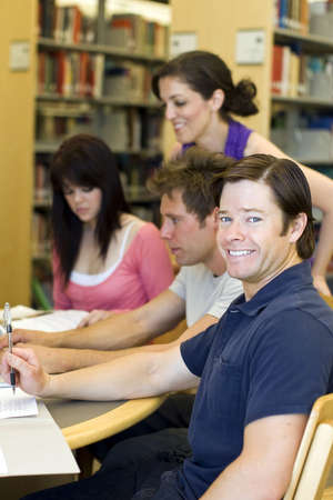 Group of students studying at the library Stock Photo - 4950037