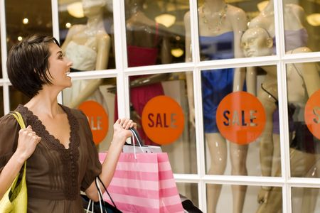 Happy woman shopping at an outdor mall Stock Photo