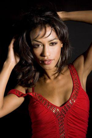Beautiful exotic woman - dramatic lighting photo