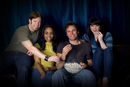 Friends watching a game eating popcorn Stock Photo - 4989258