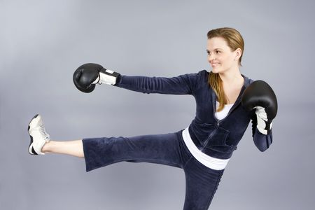 young woman exercising with boxing gloves