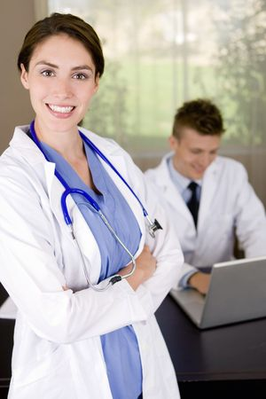 Friendly young medical professionals working in an office Stock Photo - 4989332