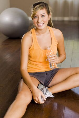 Young woman exercising at a gym Stock Photo - 5047202